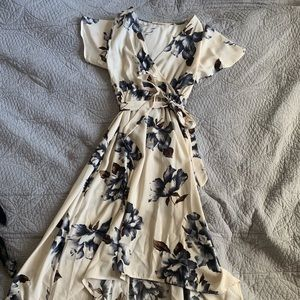 Cream high to low dress with blue flowers